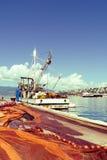 Spread fishing nets, fishing boat on dock. In port of Rijeka, Croatia royalty free stock photo