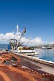 Spread fishing nets, fishing boat on dock. In port of Rijeka, Croatia royalty free stock image