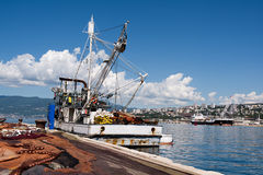 Spread fishing nets, fishing boat on dock. In port of Rijeka, Croatia stock image