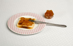 Spread jam on bread Royalty Free Stock Image