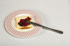 Spread jam on bread Royalty Free Stock Photography