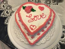 Spread the Love. Heart-shape cake for Valentine& x27;s Stock Image