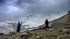 Spread lung ta. Two tibetan people were throwing off lung ta in the way of circumating the Mt.kailash Stock Image