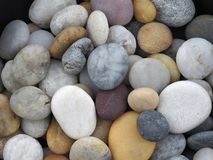 Spread and mixed beach pebbles in soft light stock images