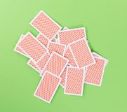 Spread out, face down cards isolated. On green background royalty free stock photos
