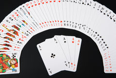 Spread playing cards on black background Stock Photography