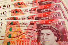 Spread of sterling 50 pound notes stock images