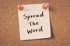Spread the word. Concept reminder message on a cork board Royalty Free Stock Image