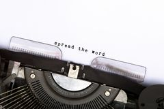 Spread the word. Typed on vintage typewriter stock photography