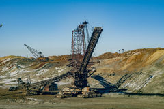 Spreader. Production of manganese ore in the largest field in Europe. Open development. Huge machines of manganese ore mined in open pits. Metallurgical industry Royalty Free Stock Images