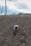 Spreader on the with seeds soil Royalty Free Stock Photo