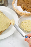Spreading aubergine sauce on bread Royalty Free Stock Photo