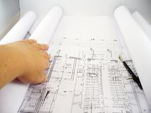 Spreading blueprints Stock Photography