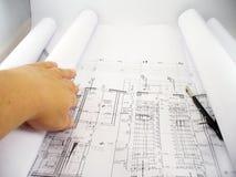 Spreading blueprints stock photography