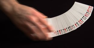 Spreading Cards. Playing cards being spread on a black surface Royalty Free Stock Photo