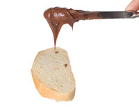Spreading Chocolate Cream On Bread Slice Royalty Free Stock Images