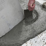 Spreading concrete Royalty Free Stock Photo