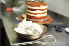 Cake cooking process. Spreading cream cake. kitchen and tools in the background Royalty Free Stock Photo