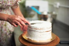 Cake cooking process. Spreading cream cake. kitchen and tools in the background Royalty Free Stock Image