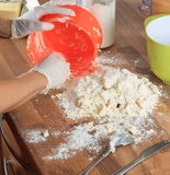 Spreading Dough on the Worktop Stock Photo