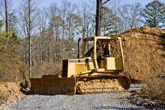 Spreading Gravel by Dirt Stock Photos