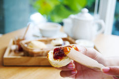 Scone With Jam. Spreading jam on a scone Stock Images