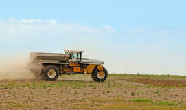 Spreading Lime. Truck spreading lime onto a farm field Stock Image