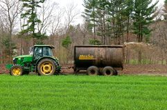 Spreading liquid manure over a field stock images