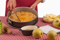 Spreading marmalade on apple pie dough Royalty Free Stock Photo