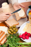 Spreading mayonnaise on sandwiches Stock Photography
