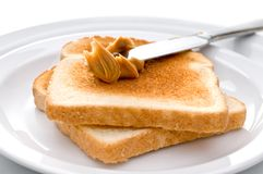Spreading peanut butter on toast Royalty Free Stock Images