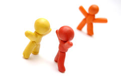 SPREADING RUMOURS. 3 plasticine figures. Spreading rumours concept Royalty Free Stock Images