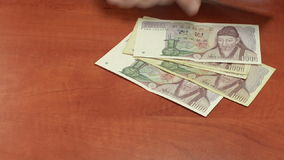 Spreading South Korean banknotes stock video footage