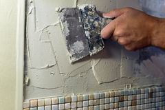 Spreading of tile adhesive with a trowel. Stock Images