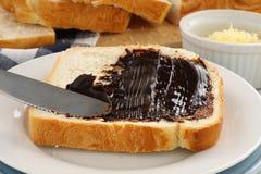 Spreading Vegemite. Spreading the iconic Australian spread vegemite on to a slice of fresh bread Stock Photos