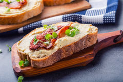 Spreads. Egg spread, grilled bacon, bread young basil leaves Royalty Free Stock Photography