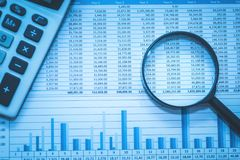 Free Spreadsheet Bank Accounts Accounting With Calculator And Magnifying Glass Concept For Financial Fraud Investigation Audit Analysis Stock Image - 100945481