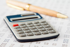 Spreadsheet with calculator and pen Stock Photo