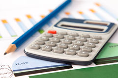 Spreadsheet with calculator and pencil Royalty Free Stock Photography