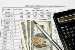 Spreadsheet Earnings Calculations. With 100 dollar bills and coins stock images