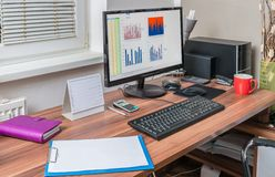 Spreadsheet processor and charts on computer in office Stock Photos