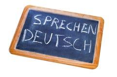 Sprechen deutsch, german is spoken. Sentence sprechen deutsch, german is spoken, written on a chalkboard Stock Image