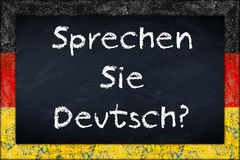 Sprechen sie deutsch blackboard with germany flag frame Stock Photos