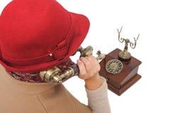 Sprechentelefon der altmodischen Frau Stockfoto