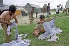 Spreco dalla fonte di reddito della conceria per la gente povera Fotografia Stock Libera da Diritti