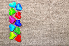 Sprectrum multi-colored hearts on a gray background Royalty Free Stock Photo