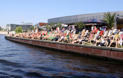 Spree Banks in Berlin. Berlin relaxation at the Spree banks on a sunny afternoon Royalty Free Stock Image