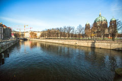 Spree river and Berlin Cathedral (Berliner Dom) is the largest Evangelical Church in Germany. BERLIN, GERMANY - NOV 17, 2014: Spree river and Berlin Cathedral ( stock photos