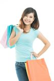 Spree season. Vertical image of a pleasant young woman with friendly smile doing shopping Royalty Free Stock Images