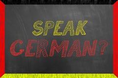 Spreek Duitse teksten op het bord van het vlagkader Royalty-vrije Stock Foto